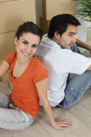 couple sat on floor photo