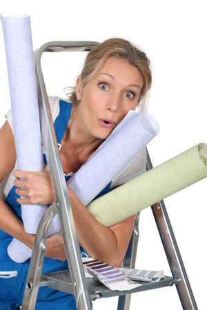 Woman with rolls of wallpaper Stock Photo - 23807546