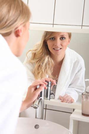 Blond woman in bathroom photo