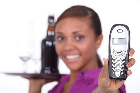 Waitress holding a phone photo