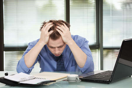 bowed: Office worker discouraged