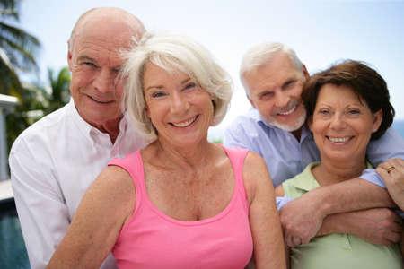 two happy senior couples photo