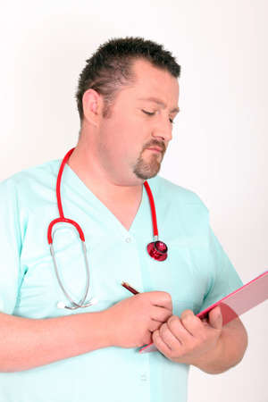 Male doctor writing on clip board photo