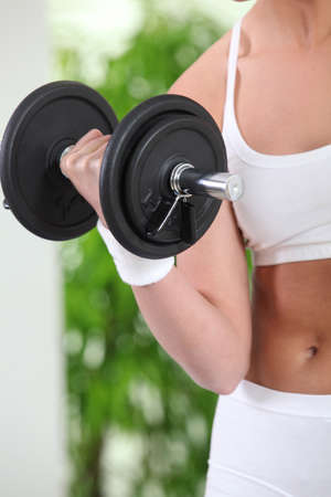 Woman lifting weights photo