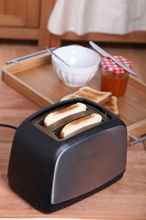 toaster: Toasting bread for breakfast