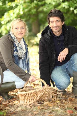 Couple gathering chestnuts photo