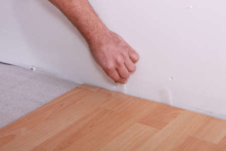 Man laying laminate flooring photo