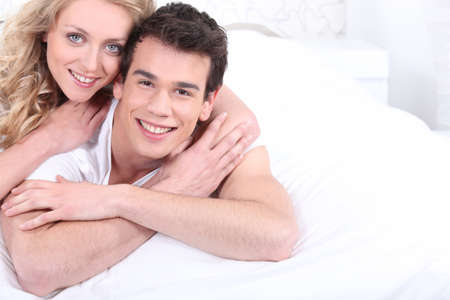 Young couple laying in bed photo