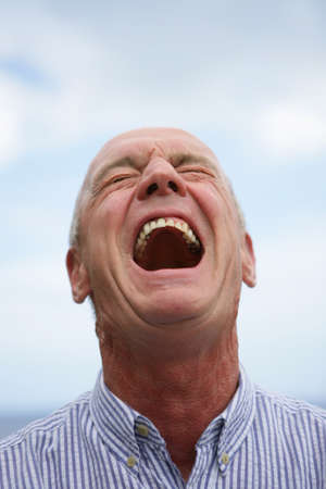 Expressive man laughing photo