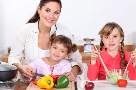 Children preparing a meal with mum photo