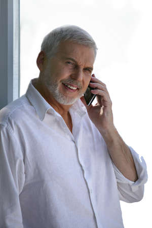 55 to 60: Middle-aged man taking a call