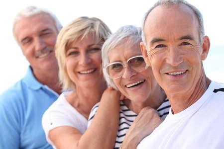 4 senior people laughing photo