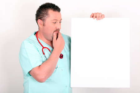 wavering: Doctor looking white sign Stock Photo