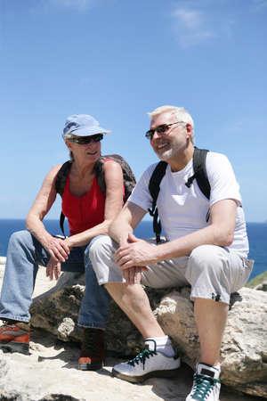 55 60 years: Couple taking a break on a hike