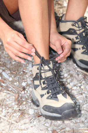 rambling: close-up of a woman doing up her shoelaces