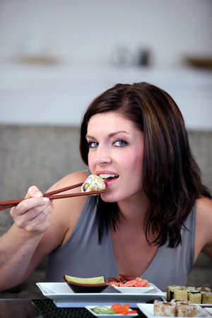 Woman eating Japanese food photo