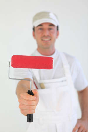prime adult: Decorator holding paint roller Stock Photo