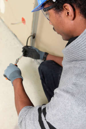 Electrician with installing cables photo