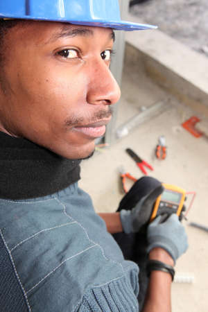 Electrician with an ampmeter photo