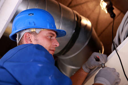 air duct: plumber at work Stock Photo