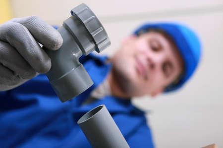 Plumber fitting plastic pipe photo