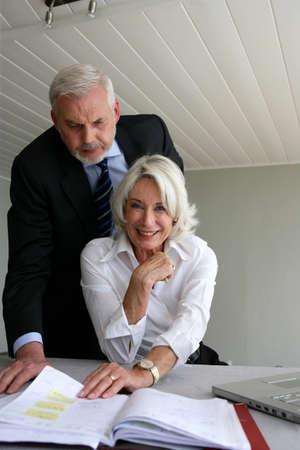 Senior business couple photo