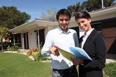 business value: young man and a real estate agent