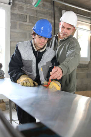 craftsman and apprentice working together photo