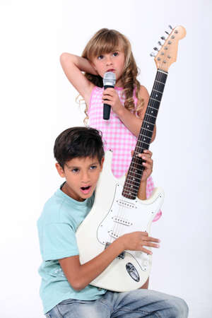 portrait of children with music instruments photo