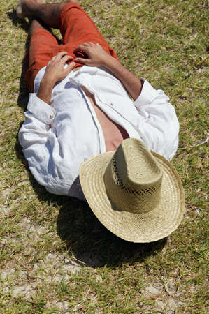 agricultural life: Man covering his face with straw hat