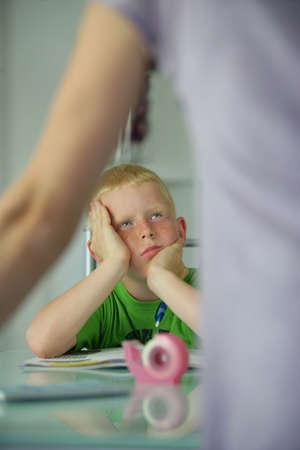 Little boy sick of doing school work Фото со стока