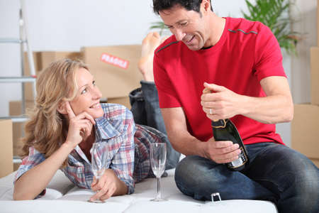 Couple drinking champagne in new home