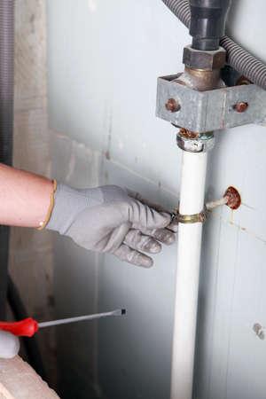 Plumber fixing bracket Stock Photo - 24083842