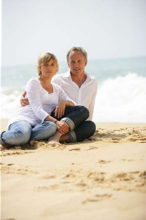 Adult couple at the beach photo