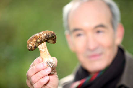 Man holding wild mushroom Stock Photo - 24084011