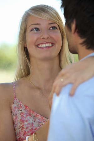 delight: Smiling girlfriend looking adoringly at her boyfriend
