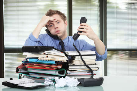 stressed man: Office worker overworked Stock Photo