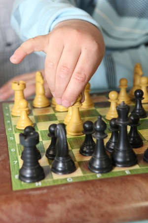 Close-up of little boy playing chess photo