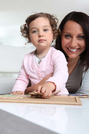 Mother and daughter with a jigsaw puzzle photo
