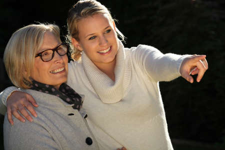 Nicely lit grandmother and granddaughter shot photo