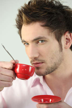 stubble: Man with cup of coffee
