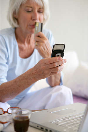 Senior woman shopping on-line photo