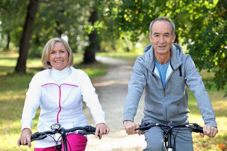 Senior couple on bike ride photo