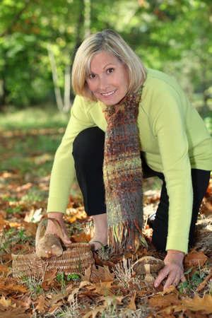 Woman gathering mushrooms photo