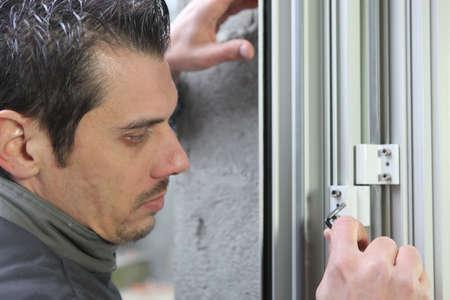 double glazing: Man installing new windows Stock Photo
