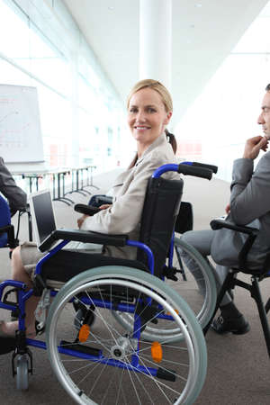Woman in a wheelchair watching a presentation photo
