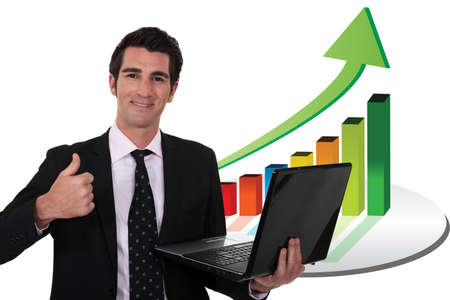 Businessman with a laptop and upward growth chart photo