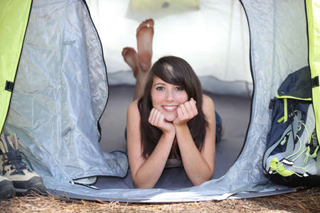 audacious: girl resting in a canvas tent