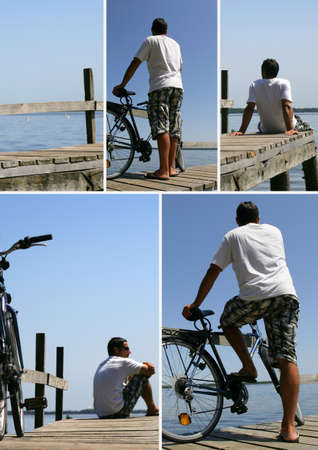 man behind: Man on a landing stage Stock Photo