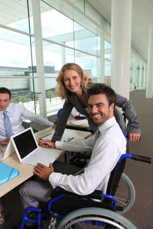 willingness: Disabled man with colleagues Stock Photo